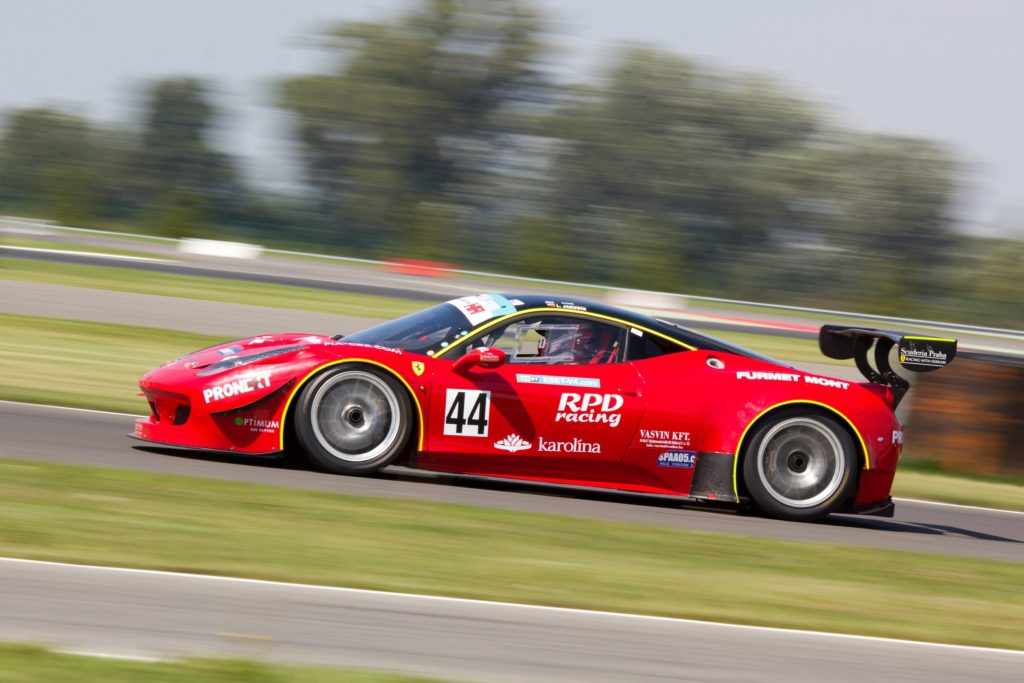 Red sports car on a racing track
